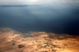 An aerial view of the coast of the Red Sea and the two islands of Tiran and Sanafir is pictured through the window of an airplane near Sharm el-Sheikh, Egypt November 1, 2016.  REUTERS/Amr Abdallah Dalsh