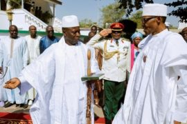 Gambia's President Yahya Jammeh welcomes Nigeria's President Muhammadu Buhari in Banjul, Gambia, January 13, 2017. REUTERS/Stringer