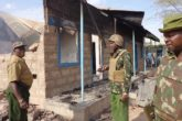Kenyan administration police officers inspect a smoldering office after a militia attack in Mandera town, northeast Kenya. Suspected Somali militia attacked Mandera Central Administration police camp and killed two administration police officers, wounded another and destroyed 12 vehicles in explosions. File Photo: XINHUA PHOTO - ADOW JUBAT