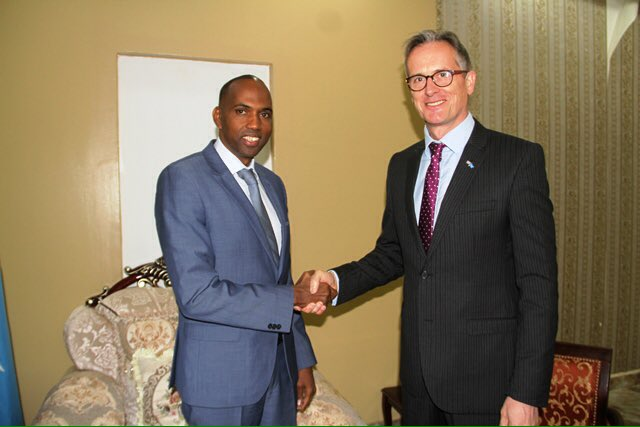 PM designate Hassan Khaire during a meeting with British envoy to Somalia David Cockar Friday. Photo: PM Office
