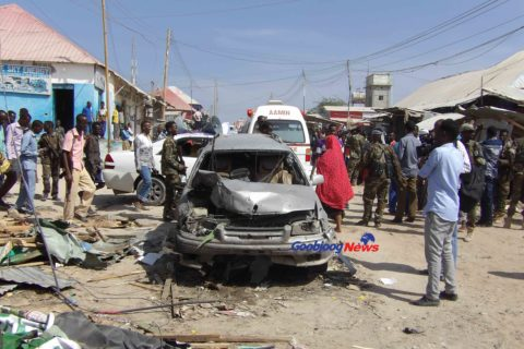 A vehicle destroyed at the scene of explosion which killed 20 people in a Mogadishu market. Photo: Ahmed Adan/Goobjoog News