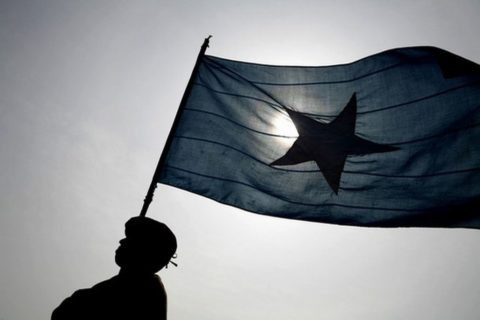 A policeman marches holding a Somali flag during a parade in Mogadishu, 11 December 2007. Photo: JOSE CENDON/AFP/Getty Images)