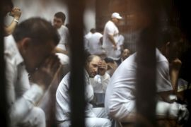 Defendants accused with murder react behind bars at a court in Cairo, Egypt, June 9, 2015. REUTERS/Mohamed Abd El Ghany