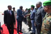 AU Commission chair Moussa Faki shakes hands with Amisom police officer on first visit to Somalia. Photo: Amisom|March 18, 2017