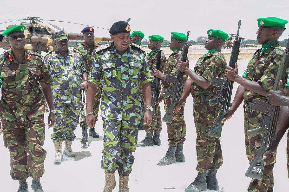 Kenya's President Uhuru Kenyatta inspecting a guard of honor during visit to KDF forces in Dhobley Somalia Saturday. Photo: State House Nairobi|March 18, 2017