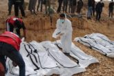 A rescue worker labels bags containing dead bodies of migrants who were washed up on a beach near the city of Zawiya, Libya February 20, 2017. Picture taken February 20, 2017.