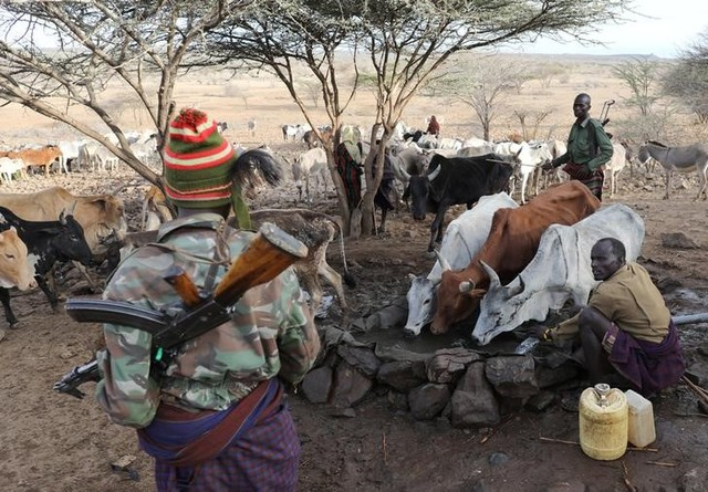 Turkana armed tribesmen stand around a borehole in order to protect their cattle from rival Pokot and Samburu tribesmen near Baragoy, Kenya February 14, 2017.    REUTERS/Goran Tomasevic