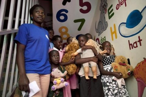 A group of HIV positive children and AIDS orphans at Reach Out Mbuya, a health clinic that does HIV/AIDS community outreach, hold stuffed animals and dolls as U.S. Picture taken August 3, 2012. REUTERS/Jacquelyn Martin/ File Photo