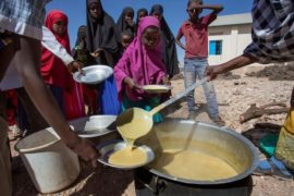 Children receive a meal at a school through the World Food Programme (WFP) in the drought-hit Baligubadle village near Hargeisa, the capital city of Somaliland, in this handout picture provided by The International Federation of Red Cross and Red Crescent Societies on March 15, 2017. The International Federation of Red Cross and Red Crescent Societies/Handout via REUTERS.