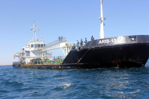 Maritime police are seen aboard oil tanker Aris-13, which was released by pirates, as it sails to dock on the shores of the Gulf of Aden in the city of Bosasso, northern Somalia's semi-autonomous region of Puntland, March 19, 2017. REUTERS/Abdiqani Hassan