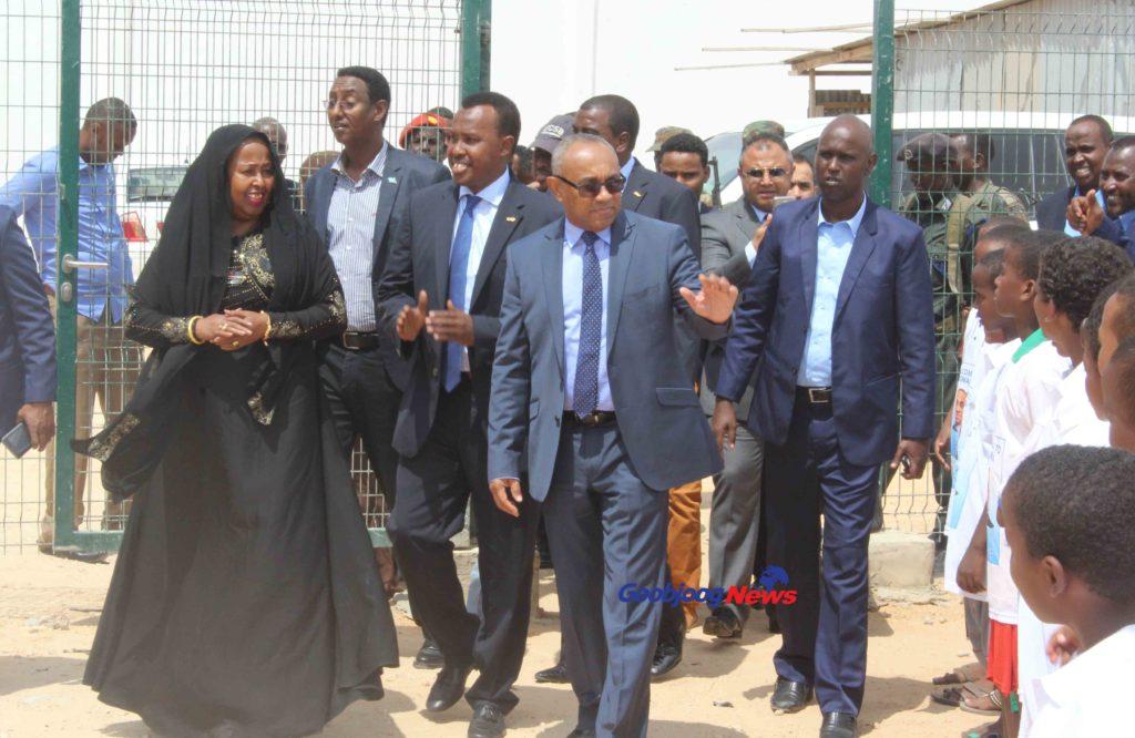 CAF President Ahmad Ahmad (c) waving at a team of youngsters at University Stadium in Mogadishu April 17,2017. Photo: Hussein Hadafow Goobjoog TV