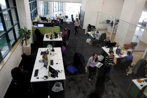 FILE PHOTO: Employees at Freightos, an online marketplace for international shipping, with investors including Sadara Ventures, a venture capital fund targeting the Palestinian high-tech sector, work at their offices in Jerusalem March 27, 2017. REUTERS/Amir Cohen/File Photo