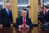 US President Donald Trump (C) waits at his desk before signing confirmations for James Mattis as US Secretary of Defense and John Kelly as US Secretary of Homeland Security, as Vice President Mike Pence (L) and White House Chief of Staff Reince Priebus (R) look on, in the Oval Office of the White House in Washington, DC, January 20, 2017. / AFP / JIM WATSON        (Photo credit should read JIM WATSON/AFP/Getty Images)