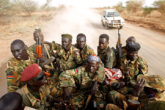 South Sudan's army (SPLA) soldiers drive in a truck in Panakuach