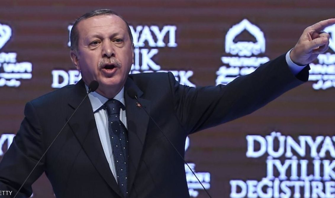 "TOPSHOT - Turkish President Recep Tayyip Erdogan gestures as he speaks in Istanbul on March 12, 2017. Turkey's President Recep Tayyip Erdogan on March 12 threatened that the Netherlands would ""pay a price"" after expelling a Turkish minister from the country. / AFP PHOTO / OZAN KOSE        (Photo credit should read OZAN KOSE/AFP/Getty Images)"