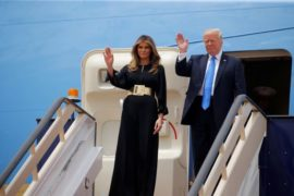 U.S. President Donald Trump and first lady Melania Trump wave as they arrive in Riyadh, Saudi Arabia, May 20, 2017. REUTERS/Jonathan Ernst     TPX IMAGES OF THE DAY