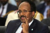 "Somalia's President Mohamed Abdullahi Mohamed, also known as Farmajo, attends his inauguration ceremony in Mogadishu, Somalia Wednesday, Feb. 22, 2017. Somalia's new leader, who also holds U.S. citizenship, was inaugurated Wednesday while promising to restore dignity to the troubled Horn of Africa nation but warning it will take another two decades to ""fix"" the country. (AP Photo/Farah Abdi Warsameh)"