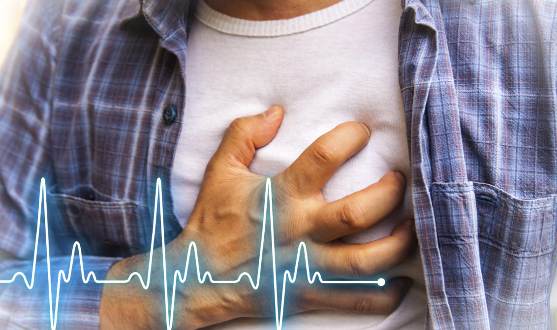 Men in blue shirt having chest pain - heart attack - heartbeat line